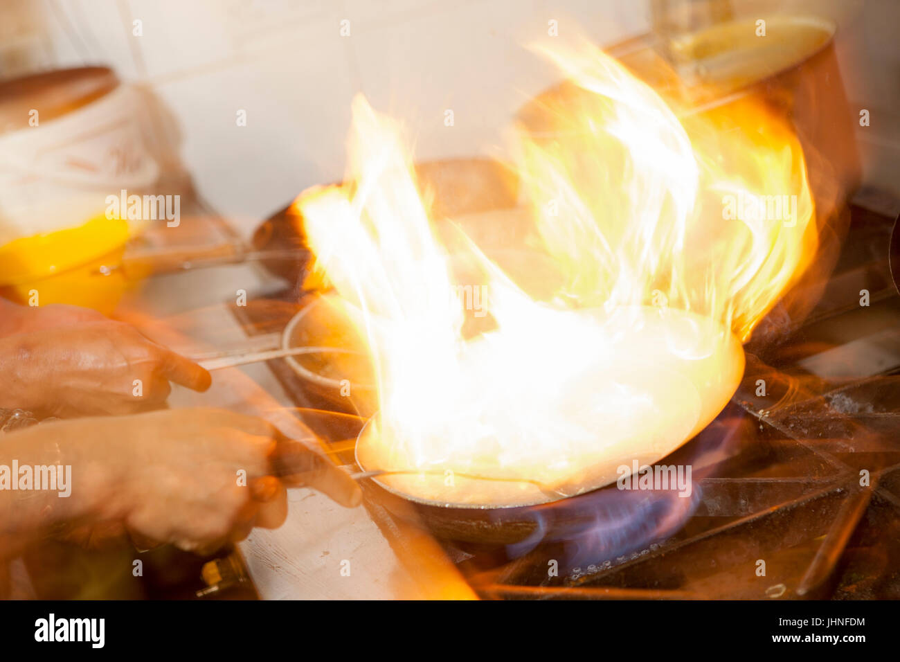 Staff prepare, cook and serve a range of  English and Bengali meals at Shazanz Kebab House in Lozells, Birmingham, - Stock Image