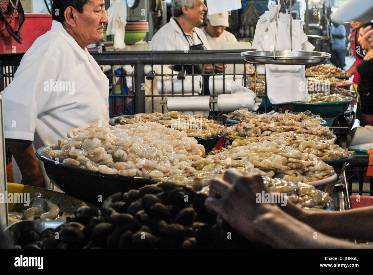 Sellers of the seafood stalls.  Municipal market.  Guayaquil, Ecuador Stock Photo