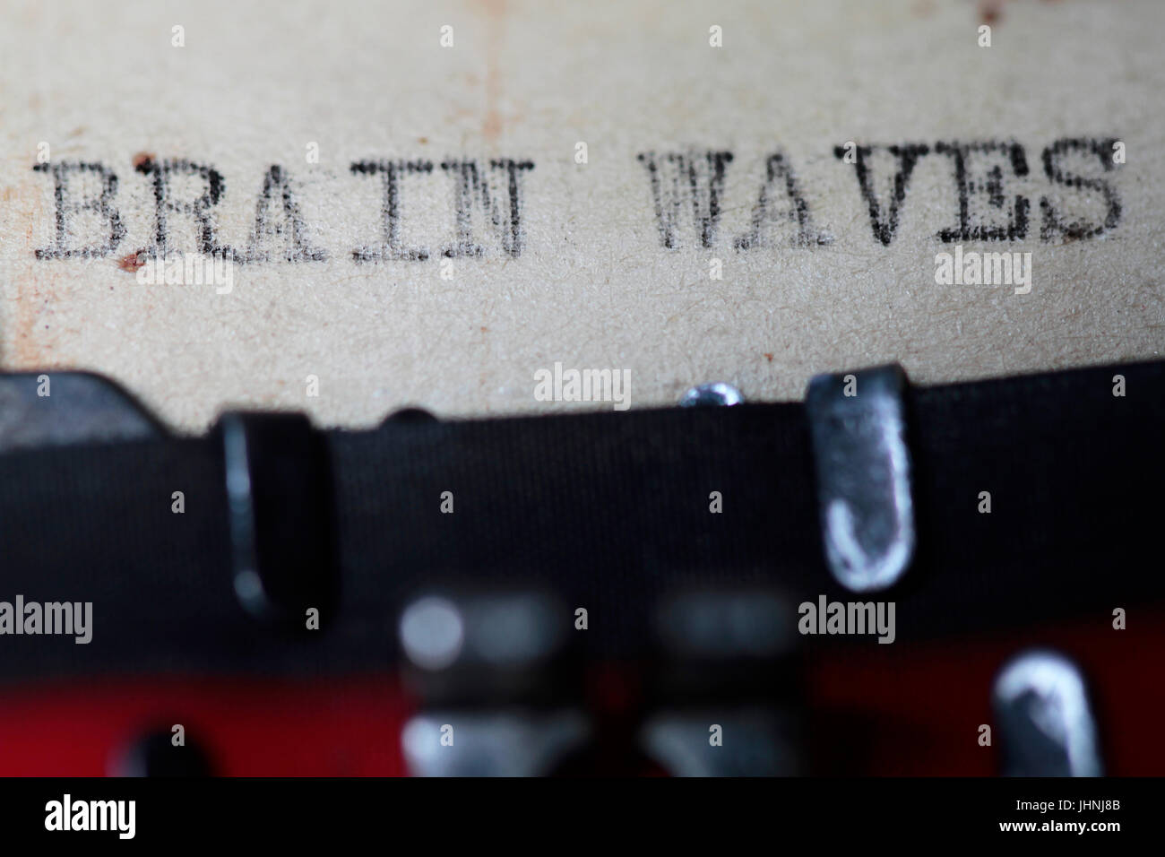 Brain waves typed in an old vintage paper - Stock Image