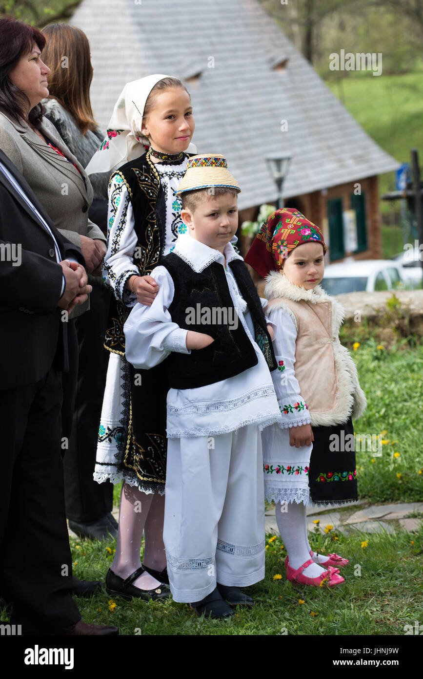 """Childs in traditional costume at """"Udatoriul"""" old agrarian custom on Easter Monday, Surdesti, District of Maramures, Stock Photo"""