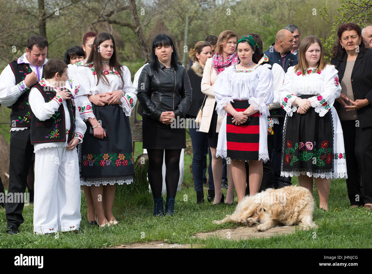 """People in traditional costume at """"Udatoriul"""" old agrarian custom on Easter Monday, Surdesti, District of Maramures, Stock Photo"""