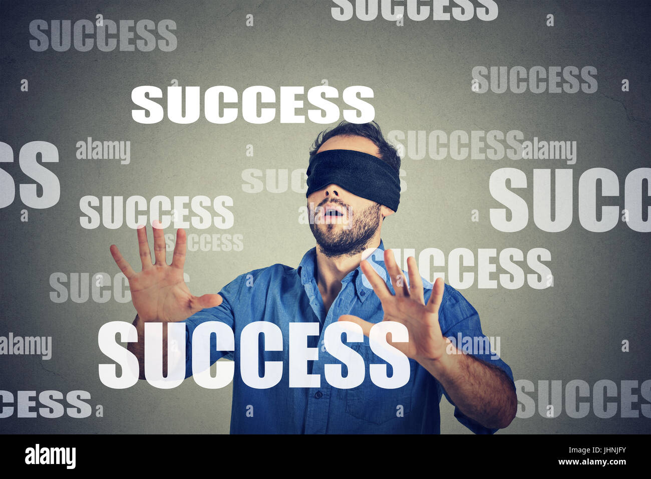 Blindfolded business man looking for success - Stock Image