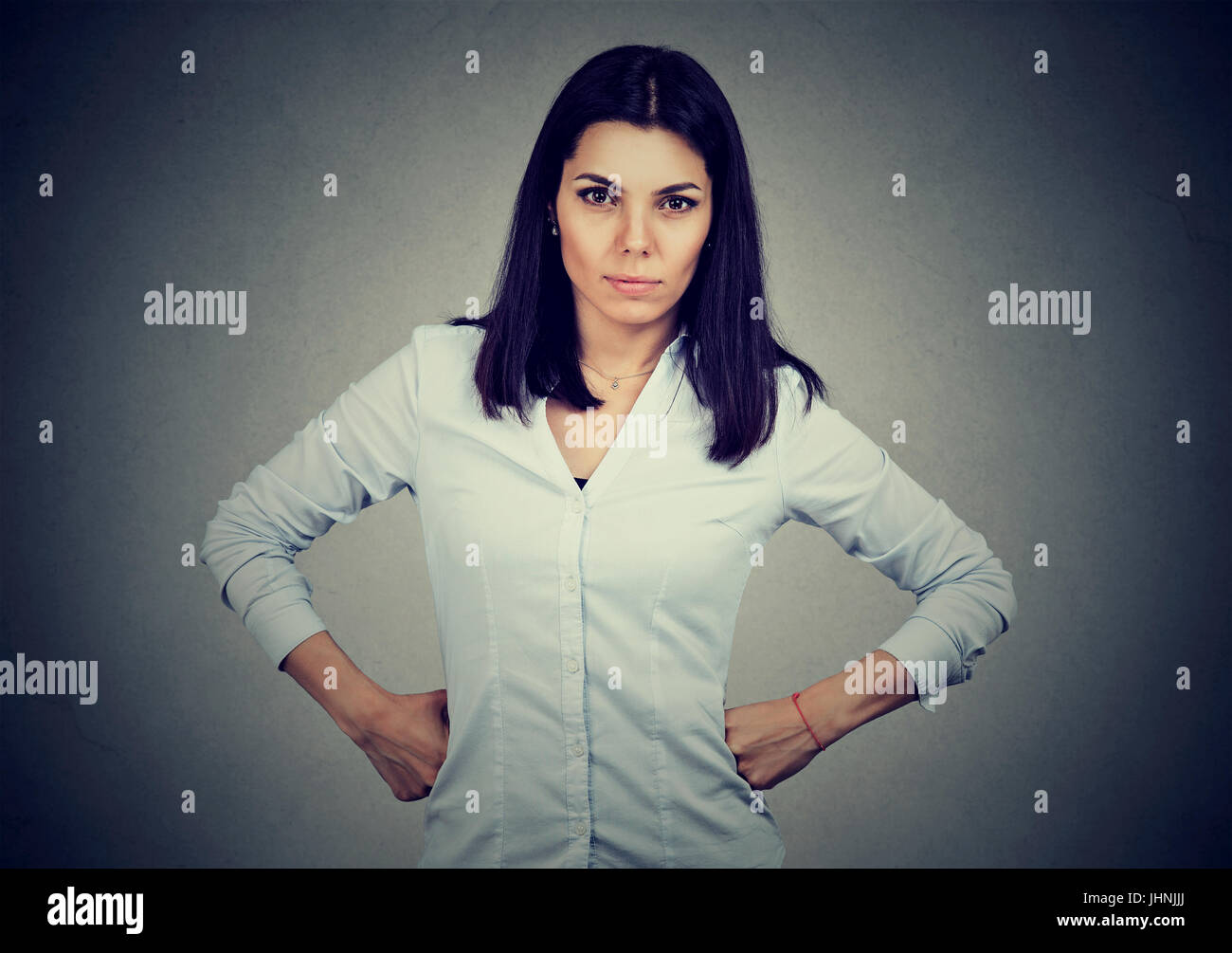 Angry brunette woman looking at camera - Stock Image