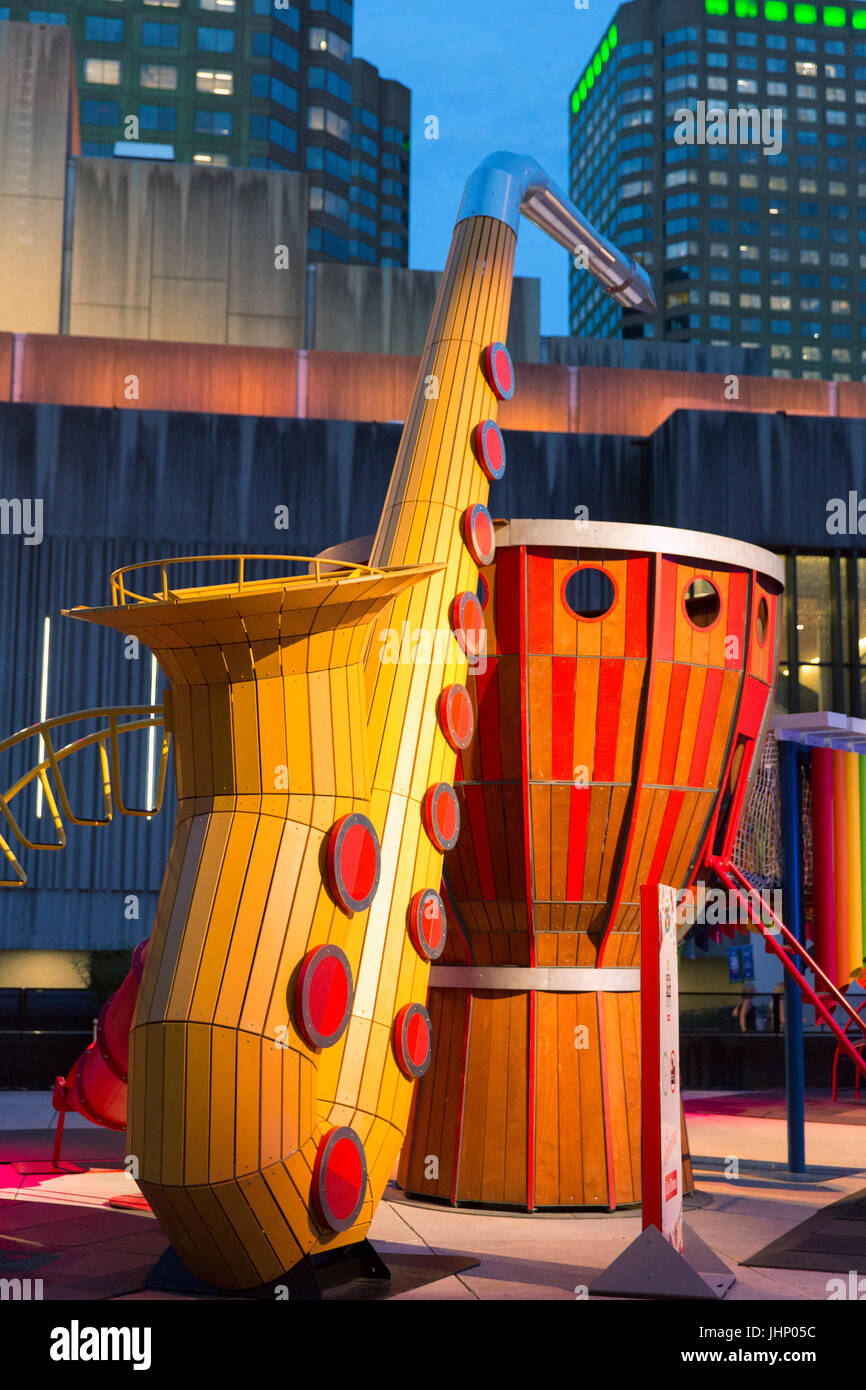 Canada,Quebec, Montreal, Montreal Jazz Festival, Place Des Festival ,childresn play station with oversize musical - Stock Image
