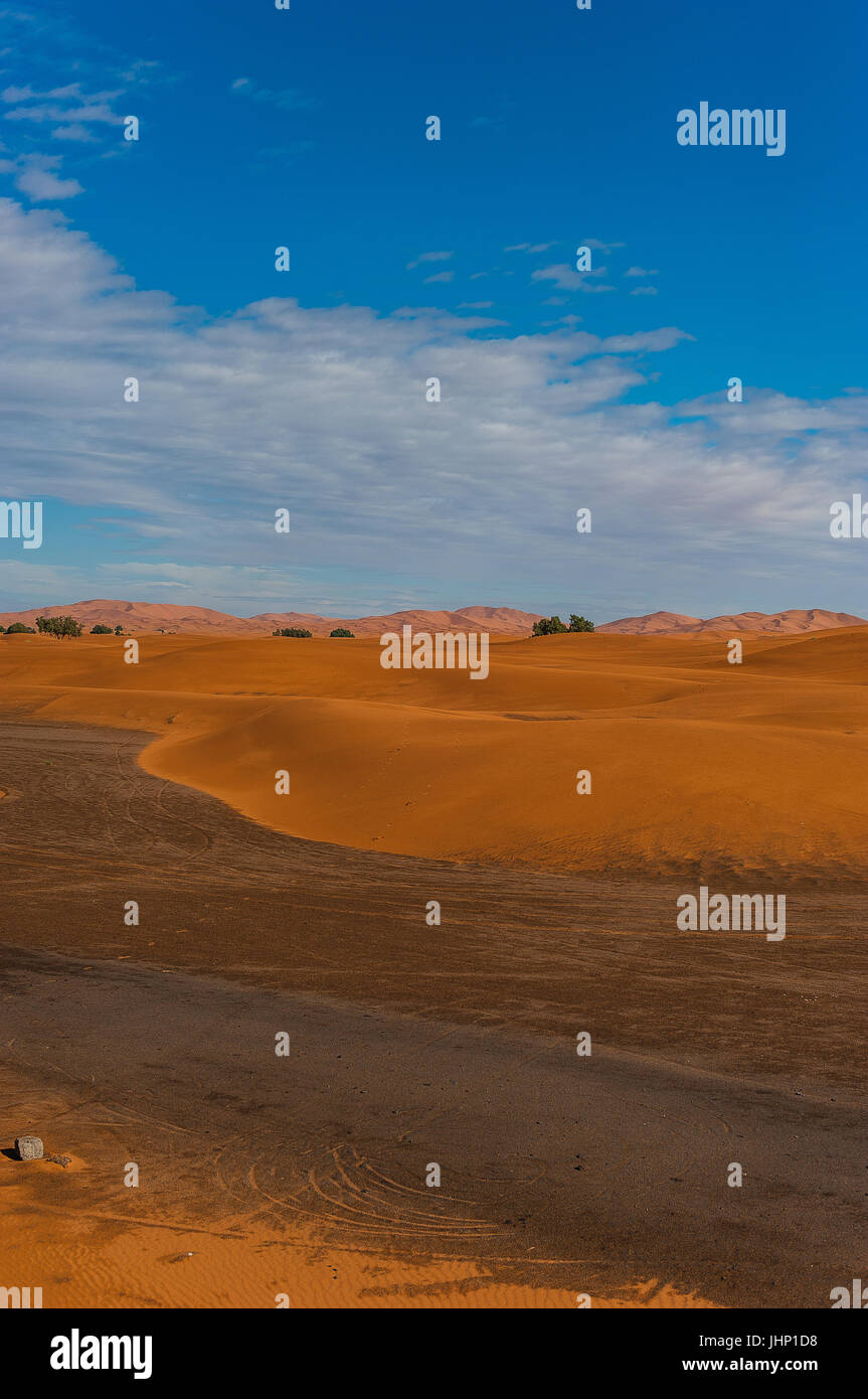 View from the dunes to the city Merzouga in Morocco, Africa - Stock Image