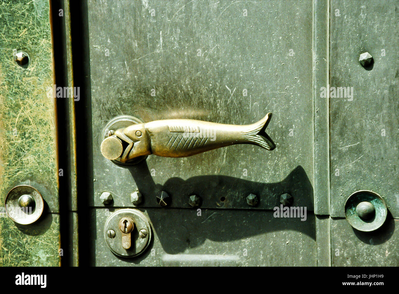 Fish shaped door handle on an old building in Germany. - Stock Image