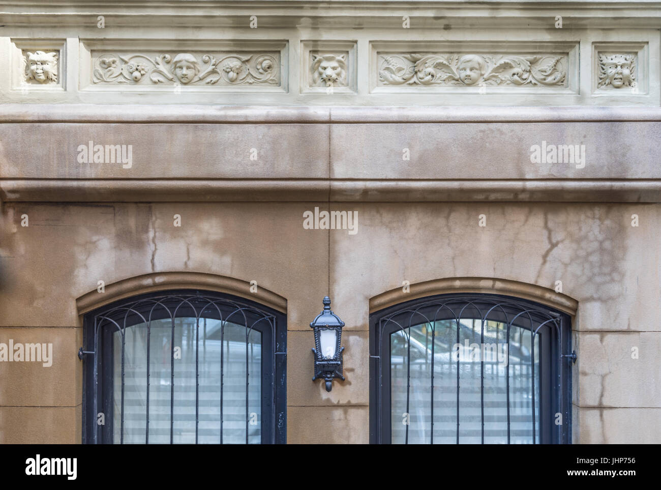 stone facade of a new york city building on the upper east side of manhattan - Stock Image