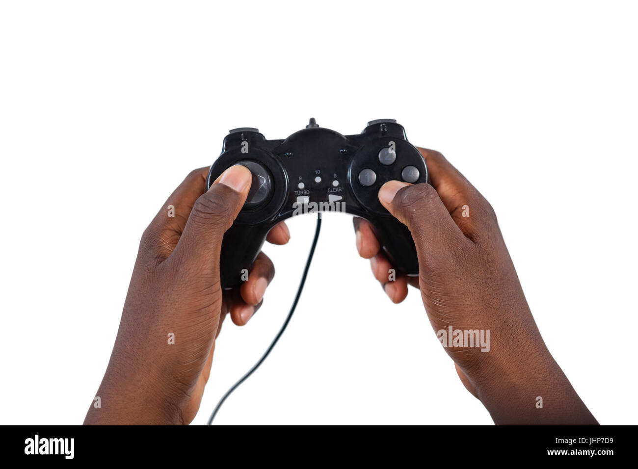 Close-up of mans hand playing video game against white background - Stock Image