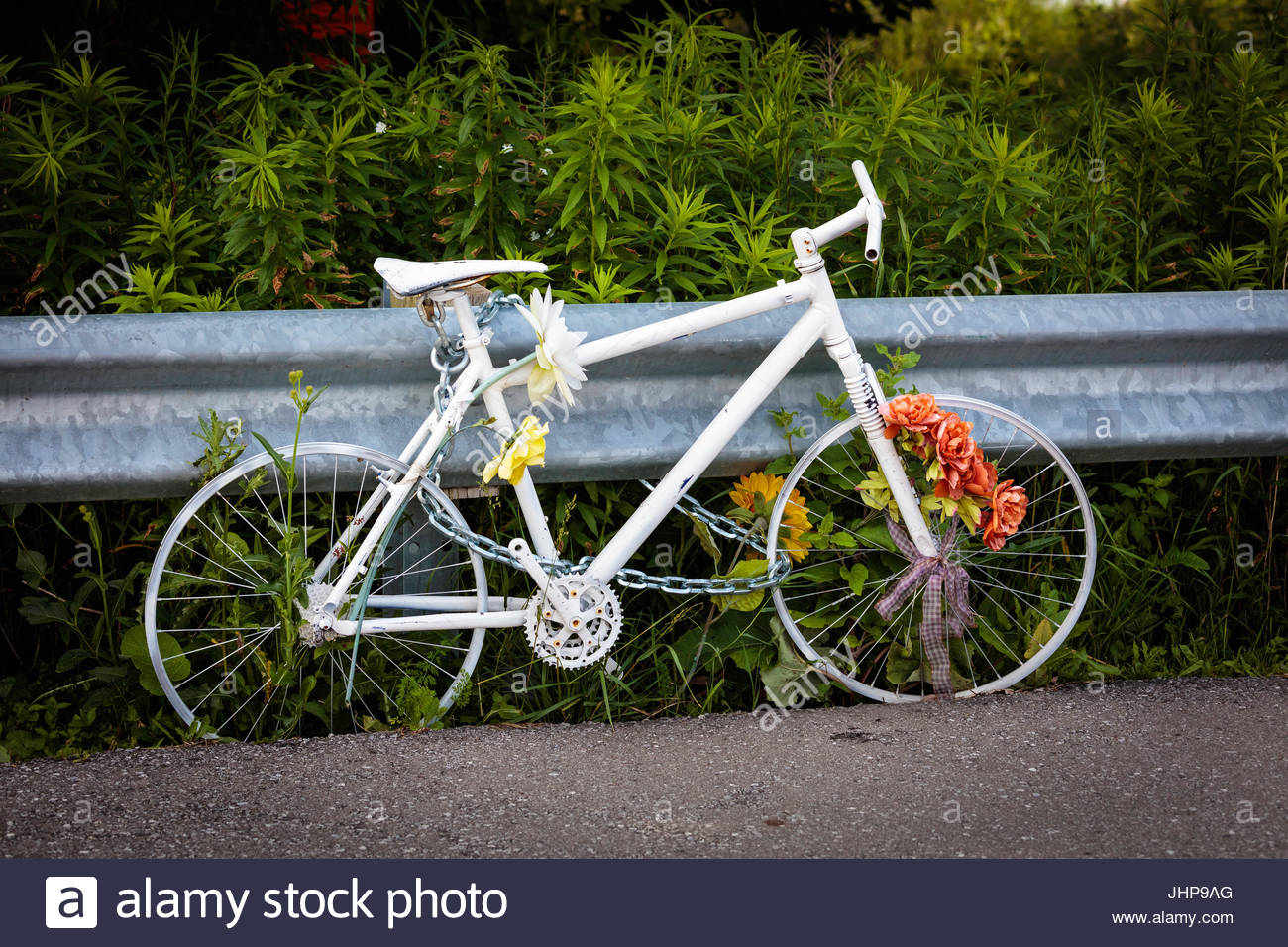 Ghost Bike ghostcycle WhiteCycle memorial reminder for cyclist killed by a train on a level crossing in Toronto - Stock Image