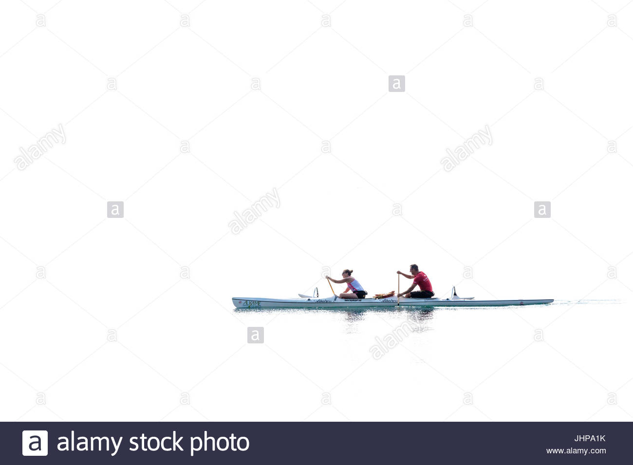couple people person paddling kayak canoe kayaking canoeing exercise healthy water sport Lake Ontario Toronto Canada - Stock Image