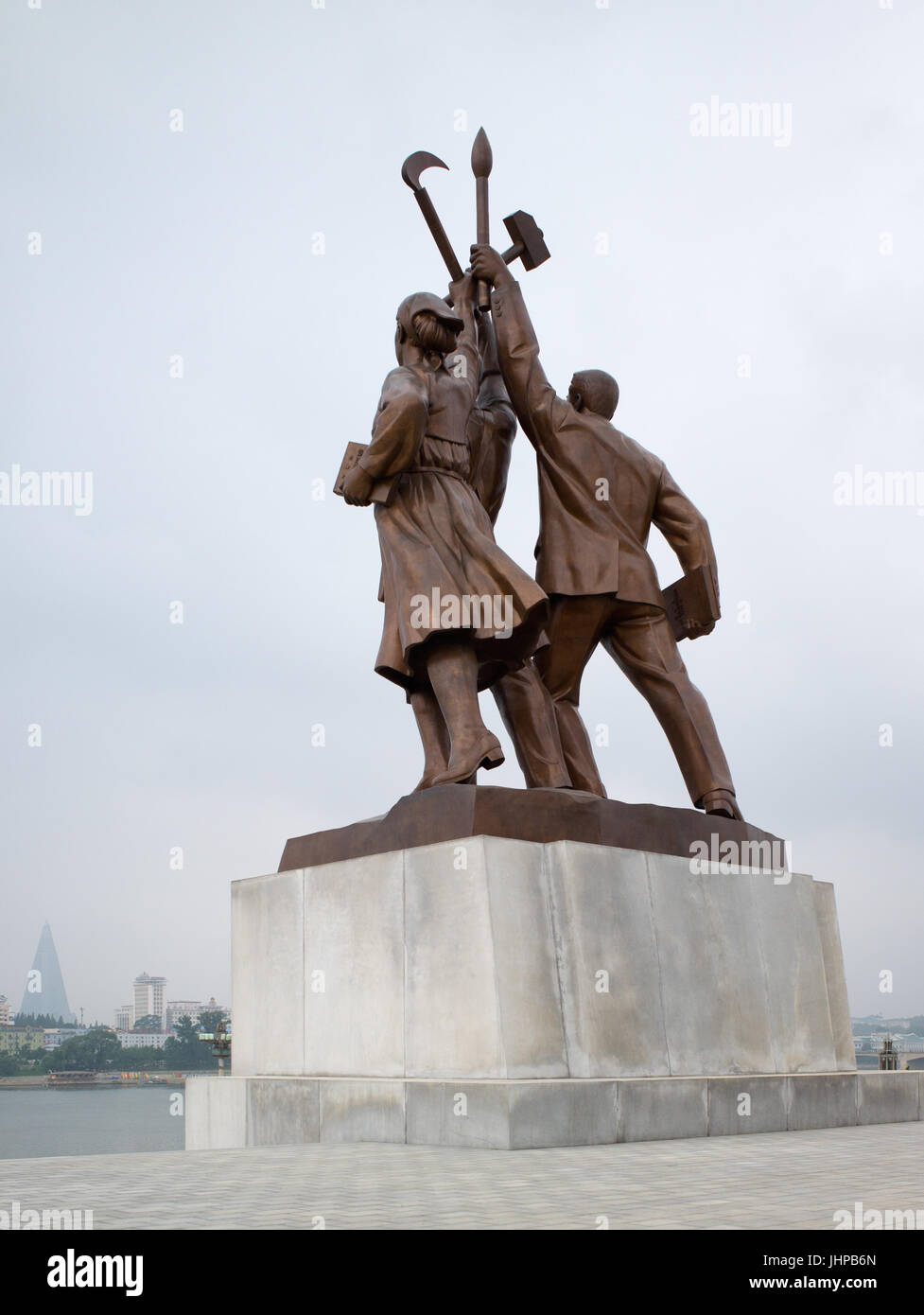 Statue symbolising intellectuals, industrial workers, and farmers, at base of Juche Tower. Pyongyang, DPRK / North - Stock Image
