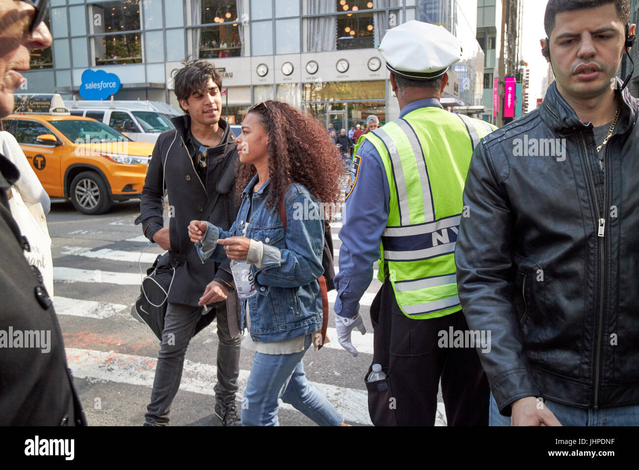 people crossing road busy intersection New York City USA - Stock Image