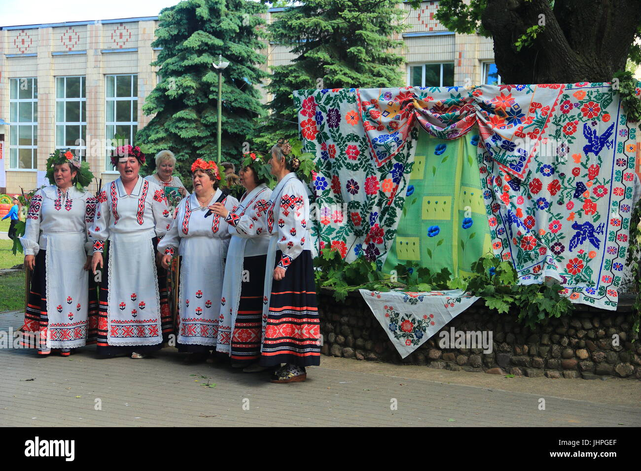 Celebrating the day of Pentecost in the village (agro-town). Performance of the song by an authentic folk band - Stock Image