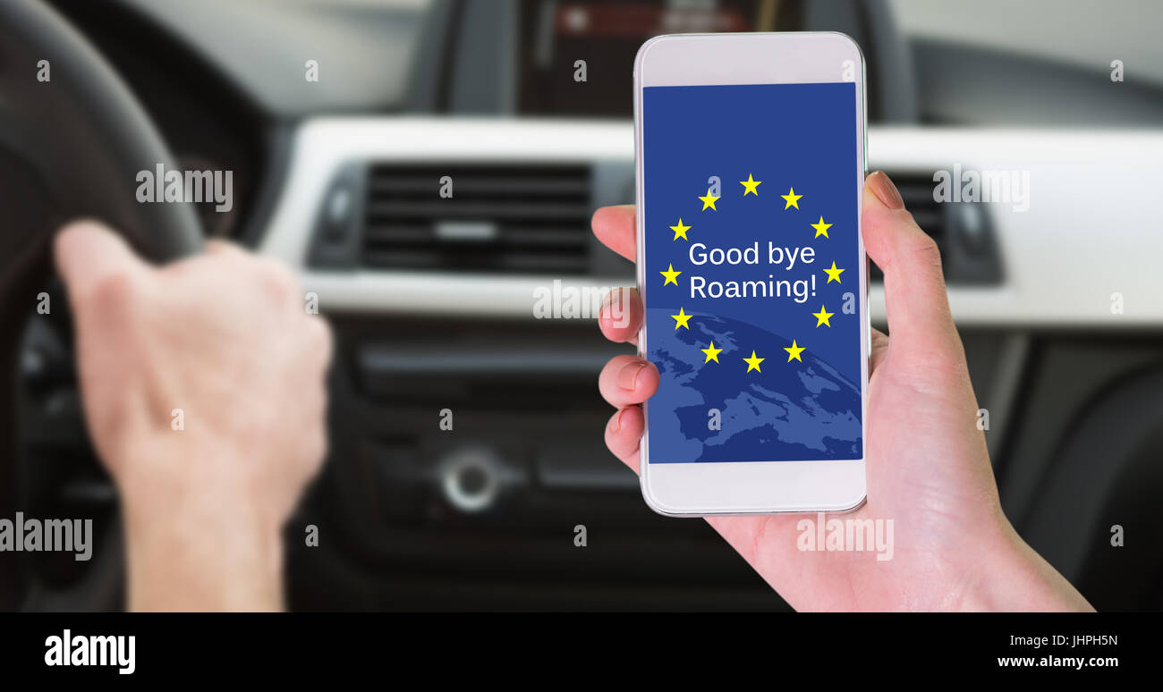Hand holding smartphone against close up of man using satellite navigation system - Stock Image