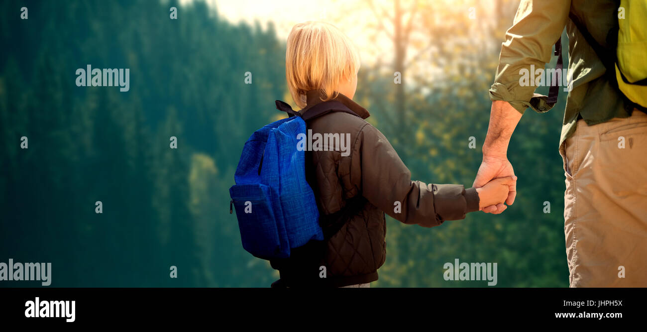 Father and son hiking together - Stock Image