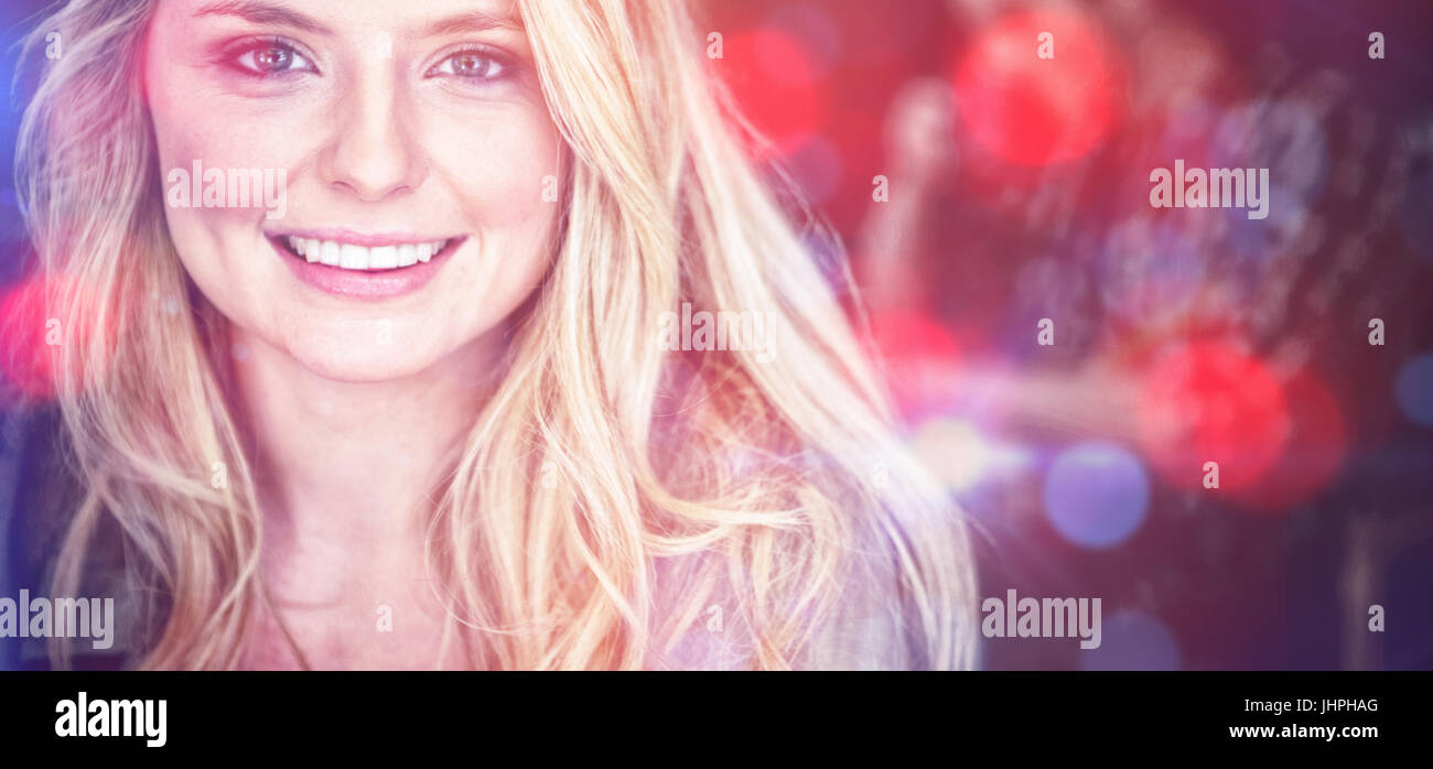 Portrait of beautiful young woman with blond hair at cafe - Stock Image
