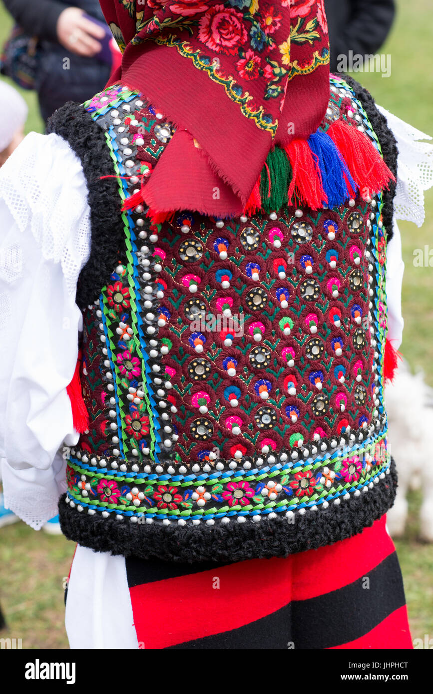 Rear of a richly decorated traditional waistcoat, village of Breb, district of Maramures, Romania - Stock Image