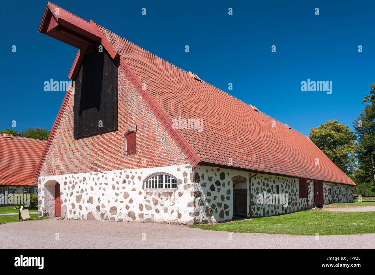 An old stone barn on the grounds of wanas castle in the rural countryside of Swedens Skane region. - Stock Image