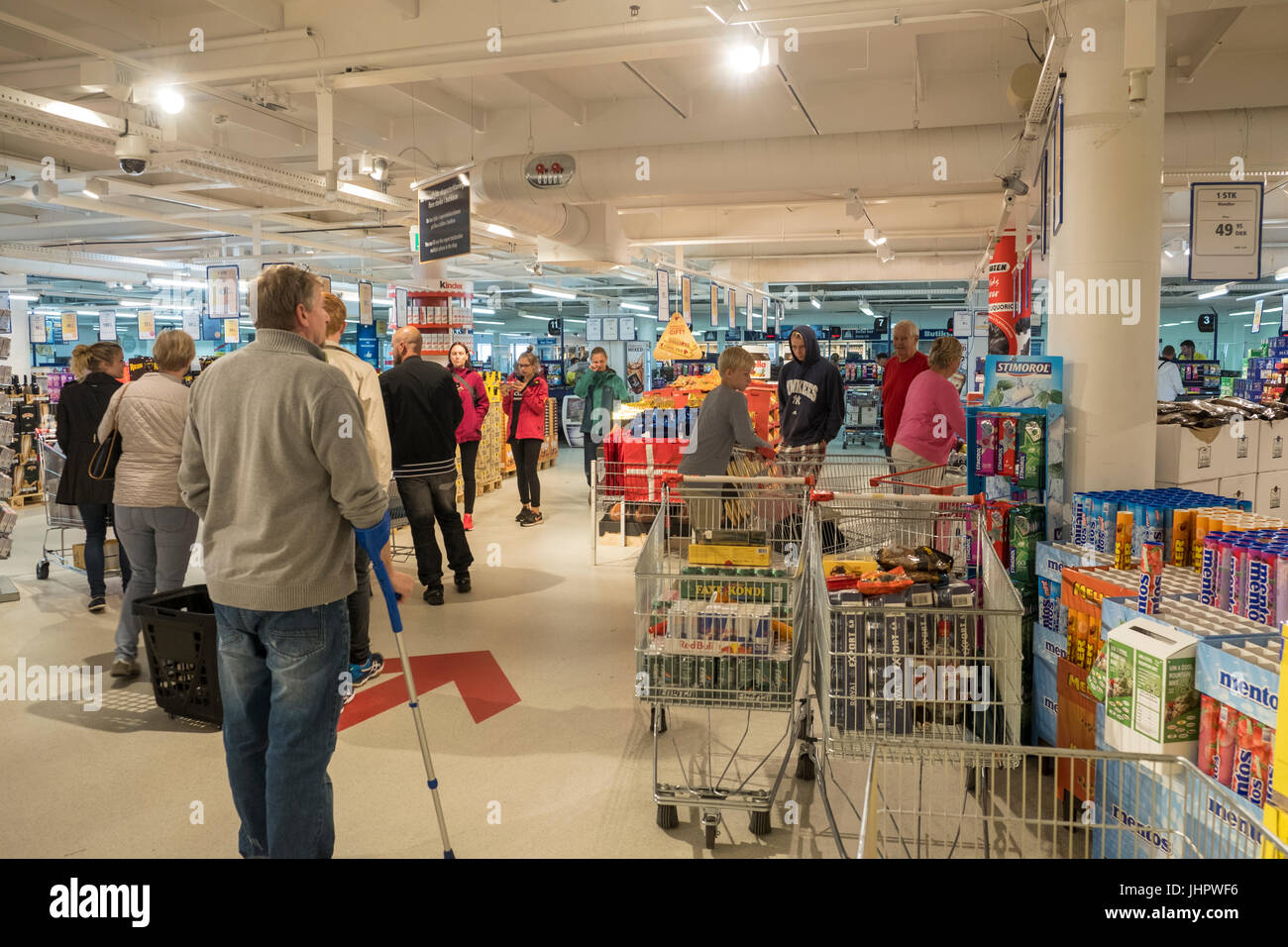 Tourists shop at BorderShop, in Puttgarden, Germany. - Stock Image