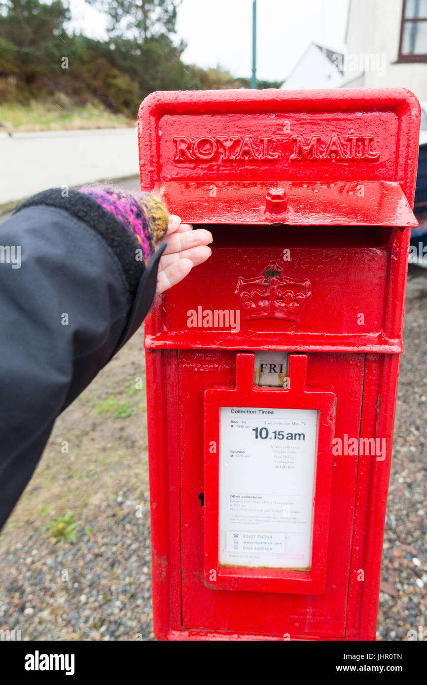 post box in Scottish Highlands with storm flap to protect against bad weather - Stock Image
