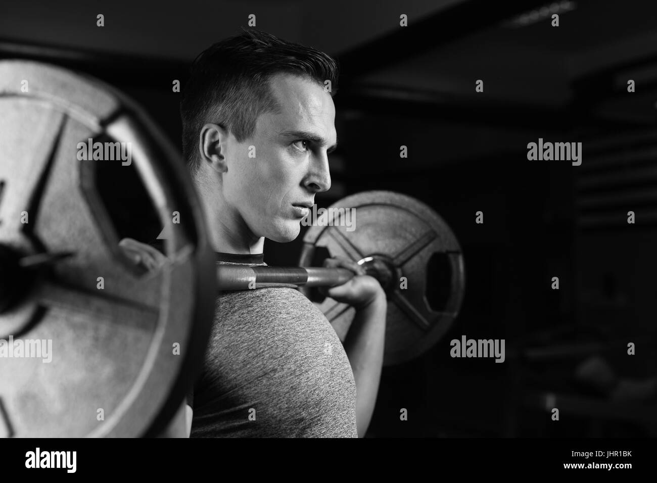 man with weight training equipment on sport gym club - Stock Image 9e14d6e651