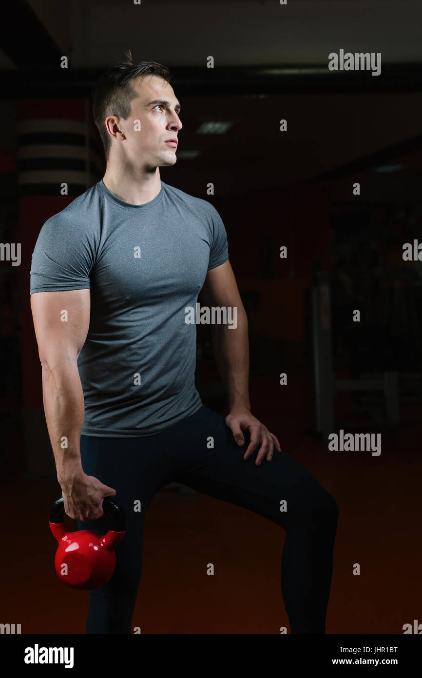 Portrait Of A Physically Fit Man In Modern Fitness Center - Stock Image