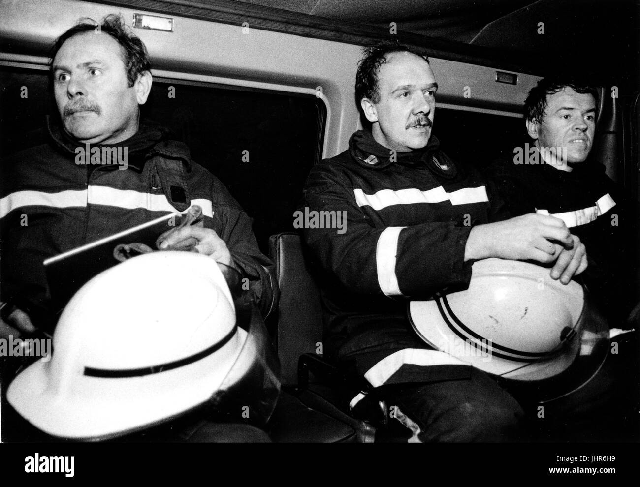 Fire fighters from West Midlands Fire Brigade get ready to go bake to their fire station after a fire has been put - Stock Image