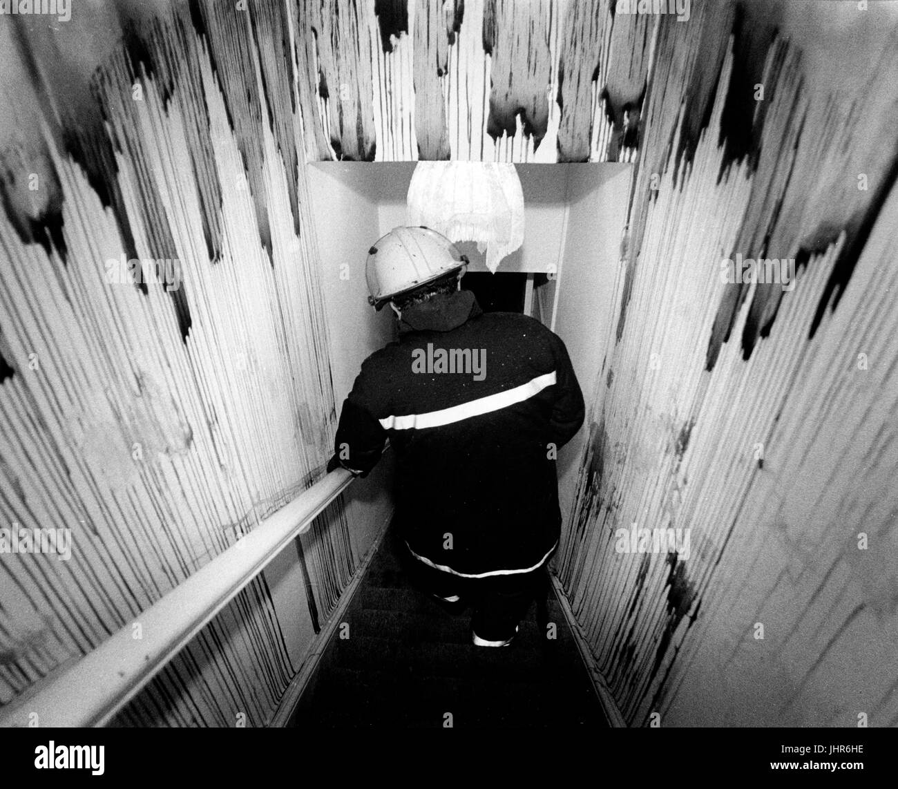 Fire fighter from West Midlands Fire Brigade leaves building after a fire has been put out in Wolverhampton - Stock Image