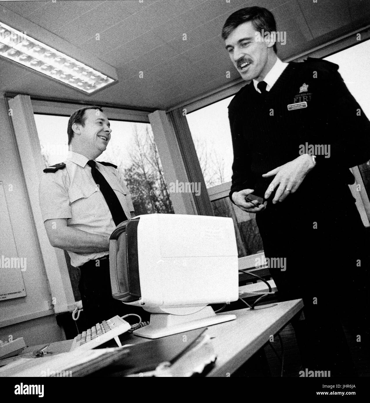 Officers from West Midlands fire brigade enjoy a joke - Stock Image