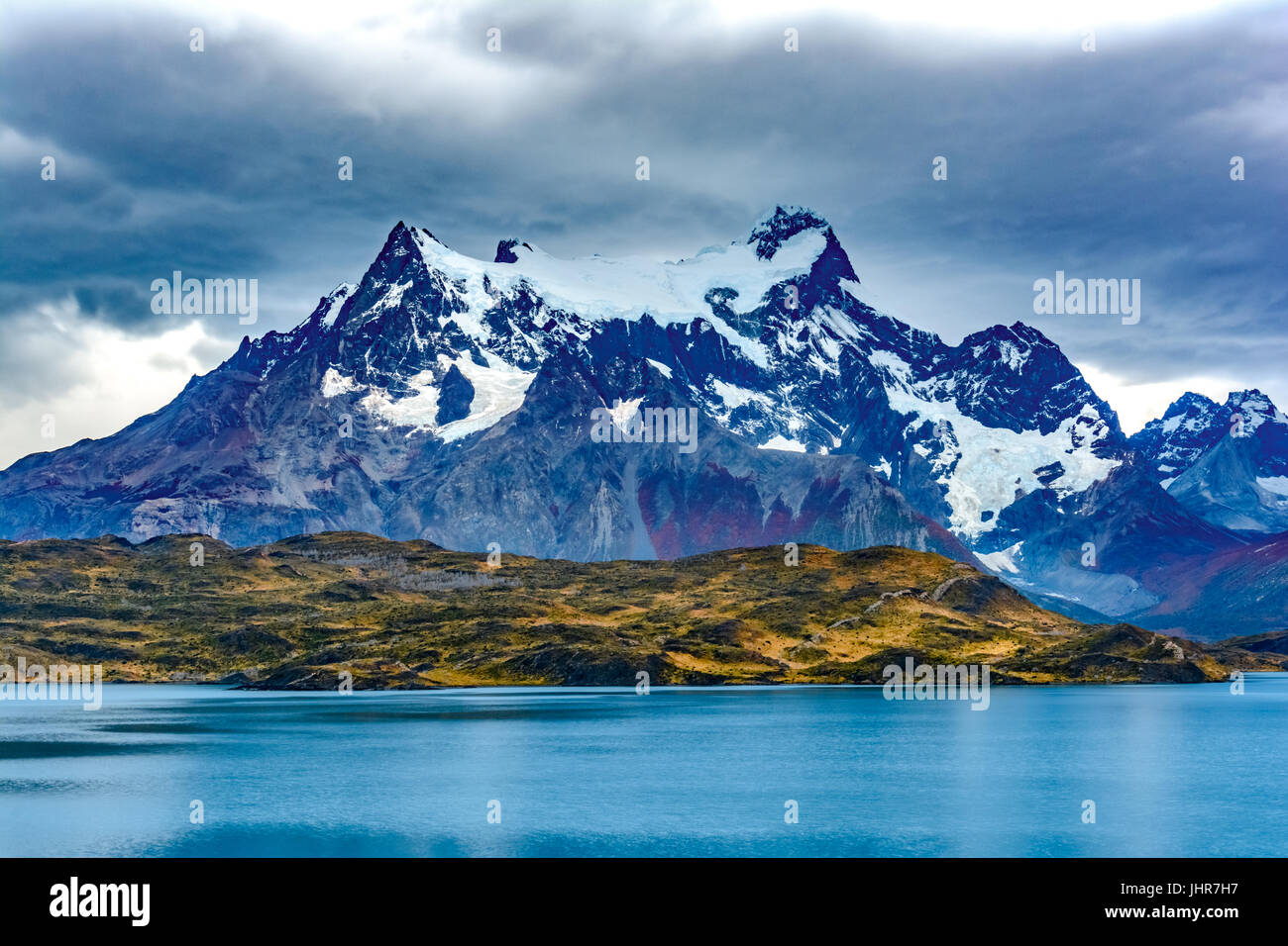 Torres del Paine over the Pehoe lake, Patagonia, Chile - Southern Patagonian Ice Field, Magellanes Region of South - Stock Image