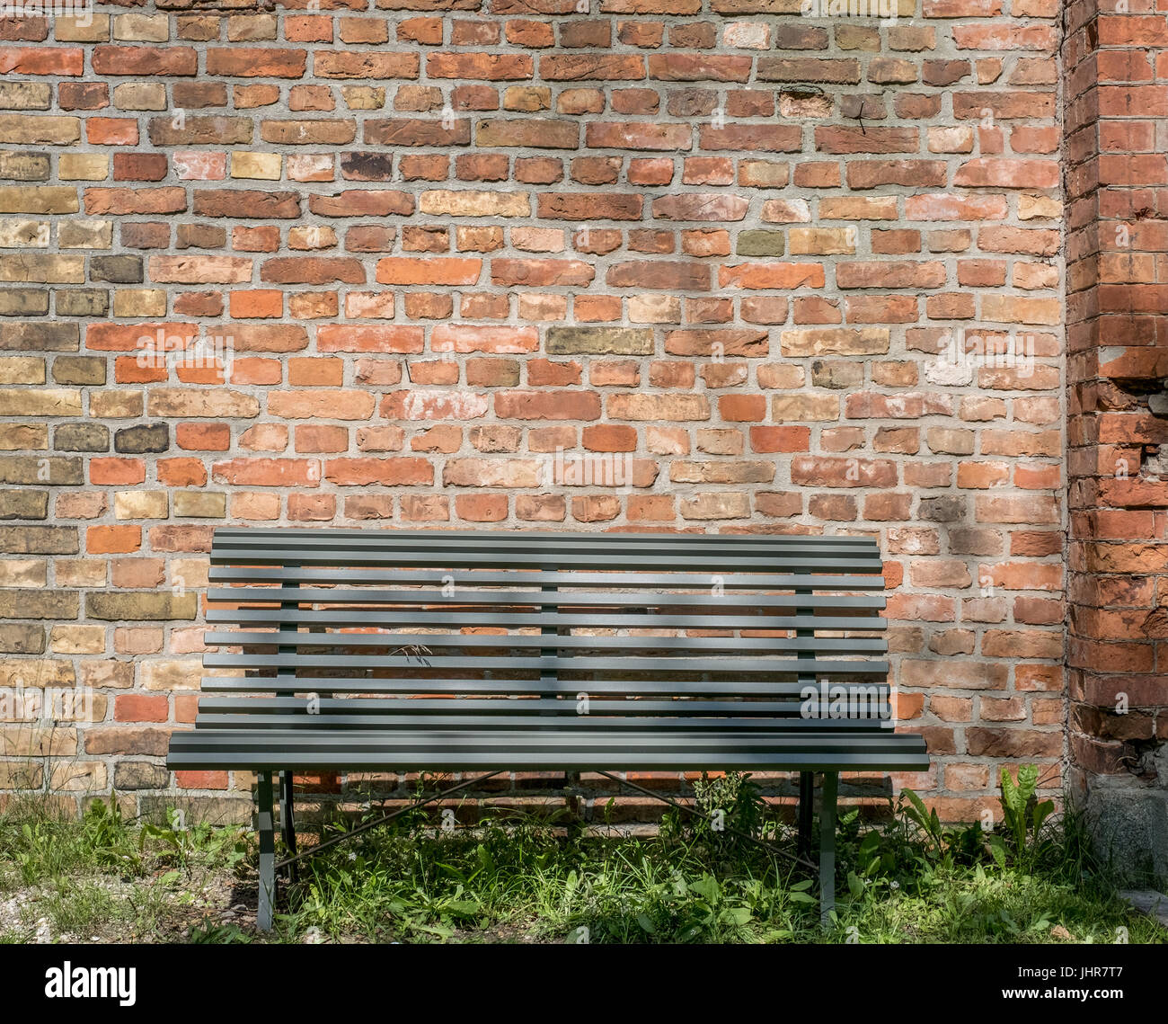 Empty Wooden Bench With Vintage Brick Wall Background