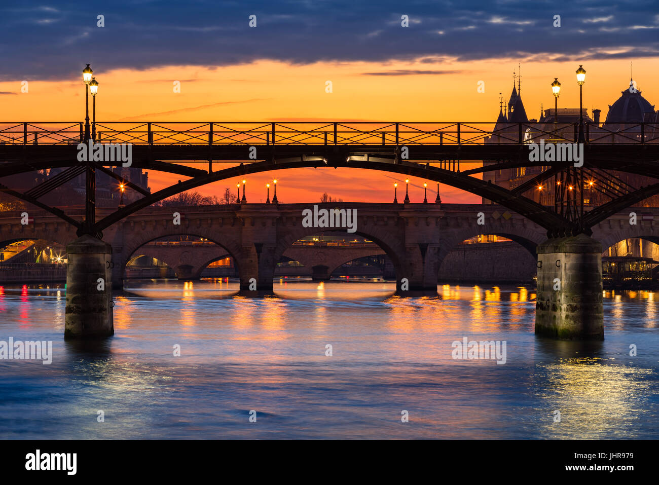 Sunrise on the Pont des Art, Pont Neuf and the Seine River Banks. 1st Arrondissement, Paris, France Stock Photo