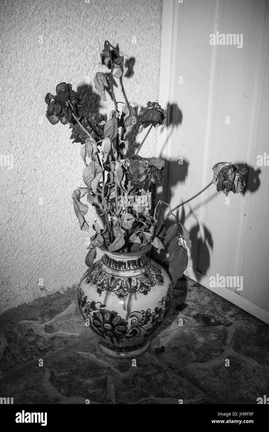 Photograph of a bouquet of flowers in an old vase Stock Photo