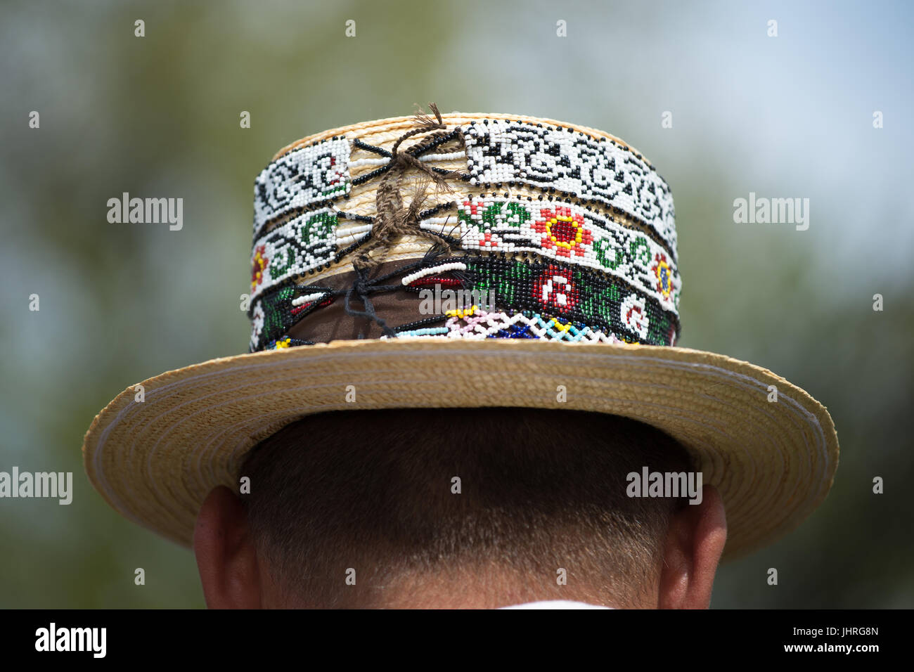 "Traditional beaded straw hat at ""Udatoriul"" old agrarian custom on Easter Monday, Surdesti, District of Maramures, Stock Photo"