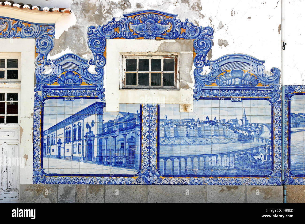 Decorative tile wall blue Azulejos on the old train station Aveiro Portugal - Stock Image