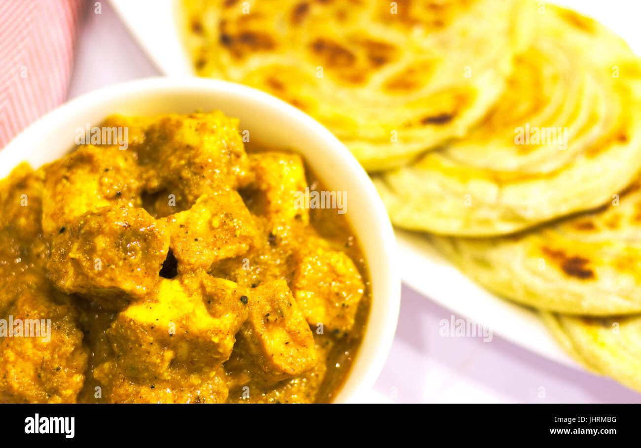 Shahi Paneer is a Sweet and Tasty Indian Dish usually served with Kerela Paratha - Stock Image