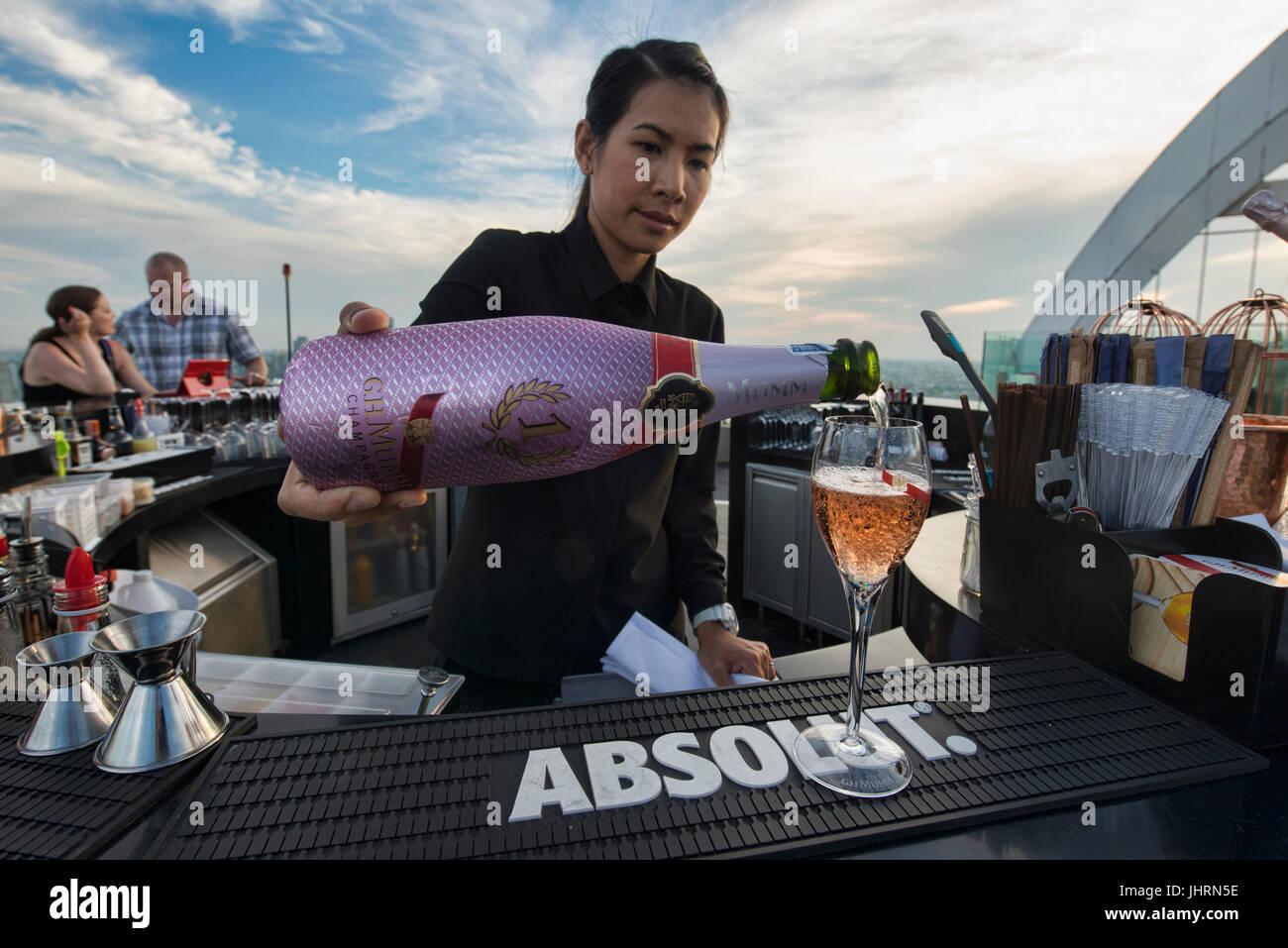 Enjoying champagne at a rooftop bar, Bangkok, Thailand - Stock Image