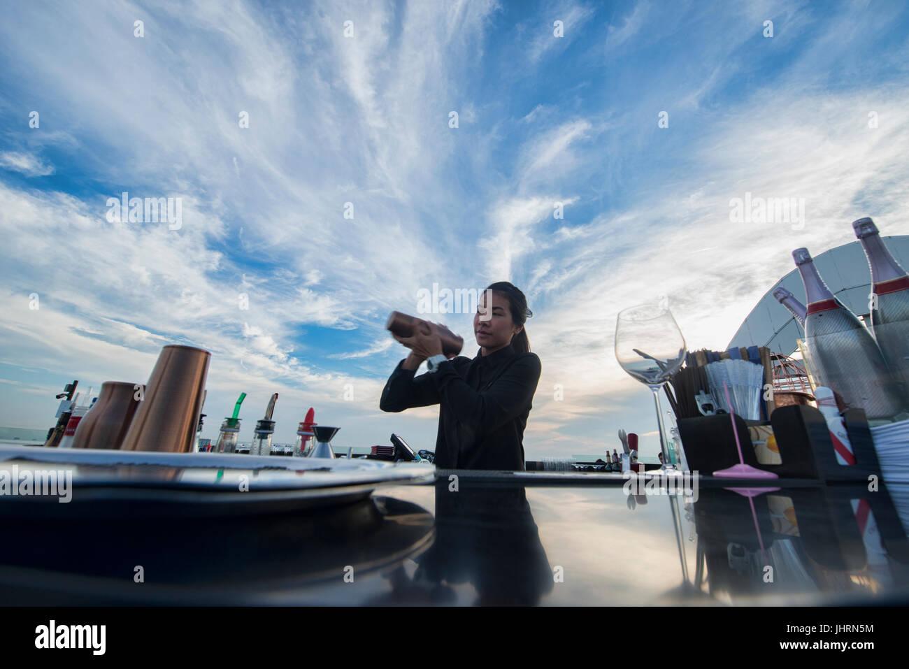Mixing drinks at a rooftop bar, Bangkok, Thailand - Stock Image