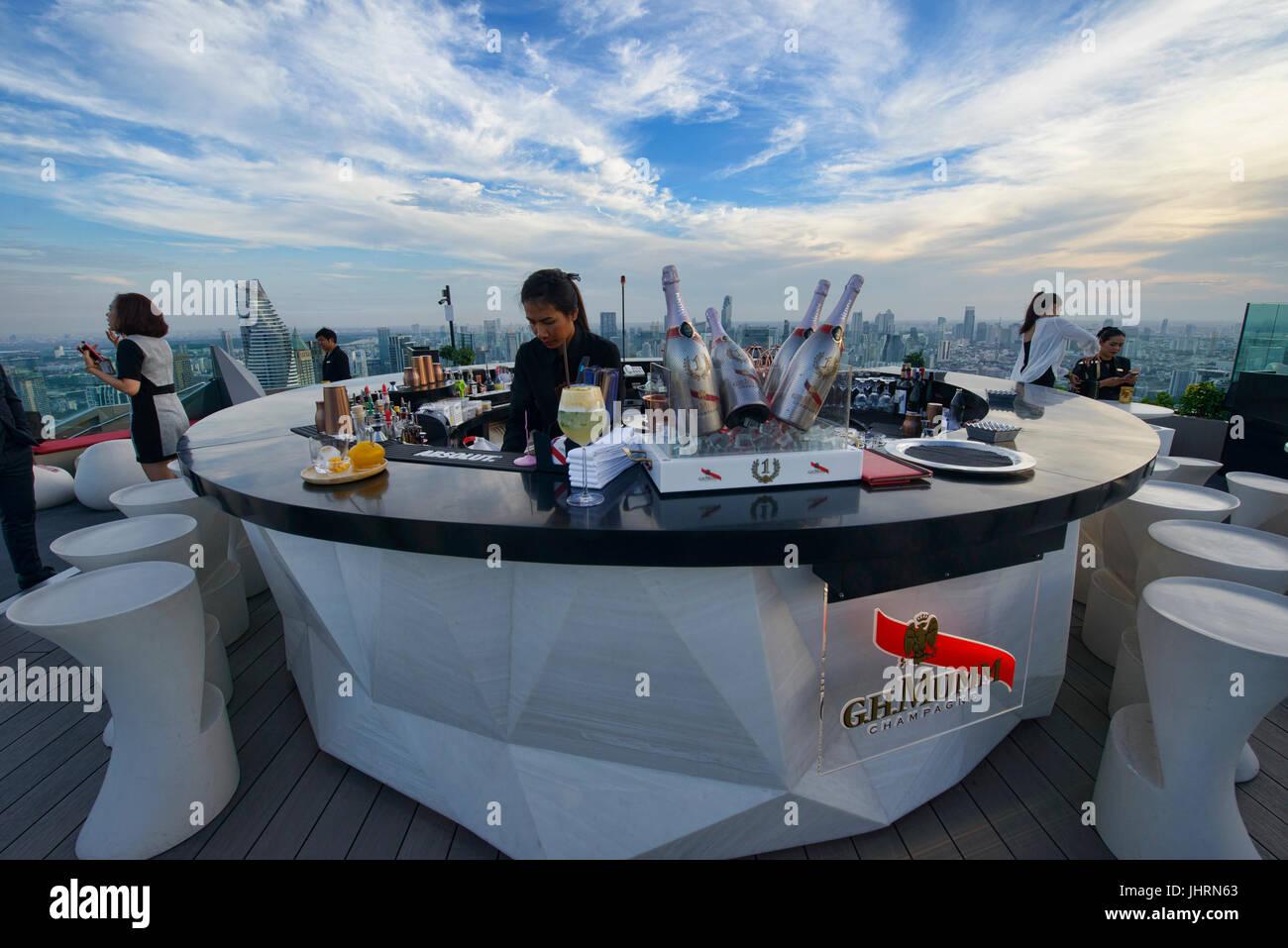 Enjoying sunset at a rooftop bar, Bangkok, Thailand - Stock Image