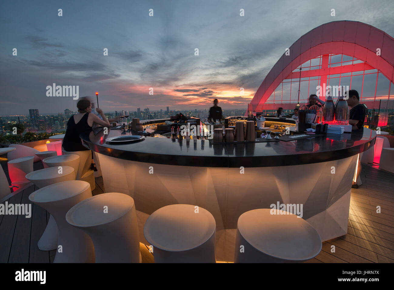 Enjoying sunset at a rooftop bar, Bangkok, Thailand - Stock Image
