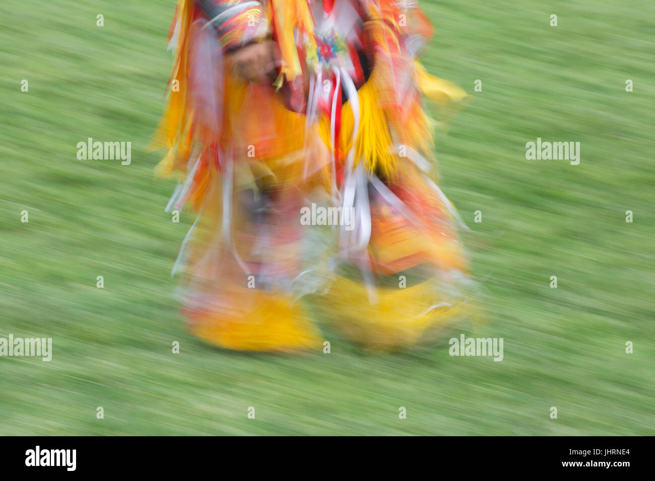 Canada Day powwow in Prince's Island Park.  The celebration commemorates Canada's 150th anniversary of confederation. - Stock Image