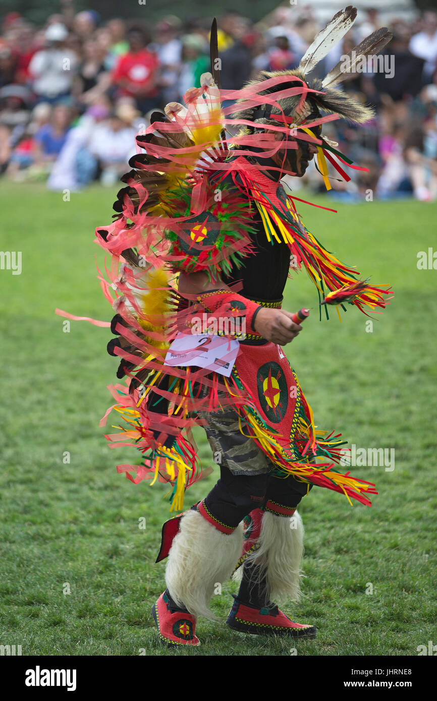 Man dancing during Canada Day powwow in Prince's Island Park.  The celebration commemorates Canada's 150th - Stock Image