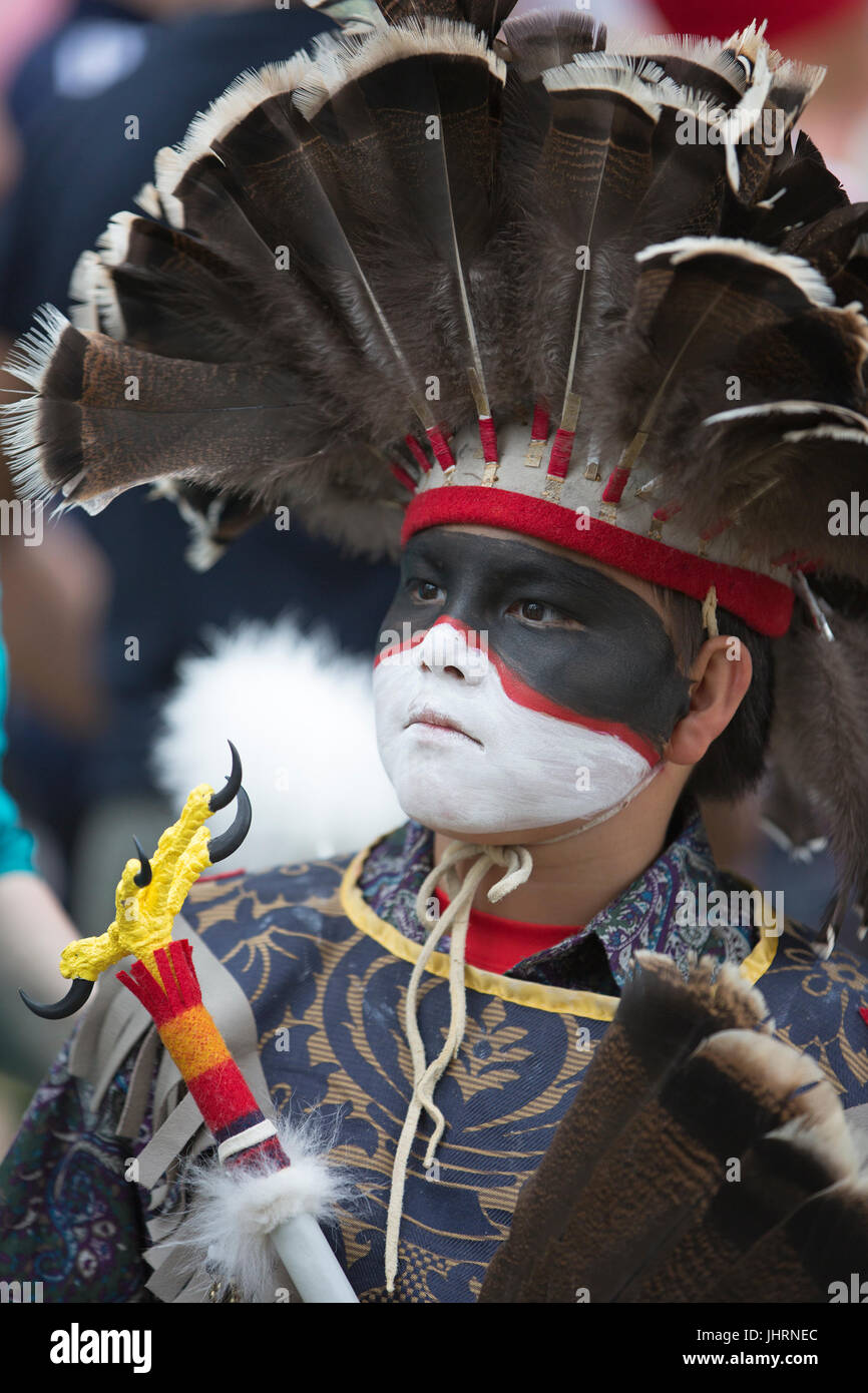 Boy with face paint at Canada Day powwow in Prince's Island Park.  The celebration commemorates Canada's - Stock Image