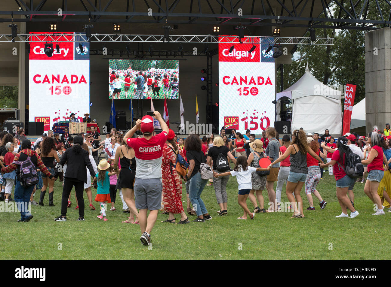 Round dance with audience participation during Canada Day powwow in Prince's Island Park celebrating Canada's - Stock Image