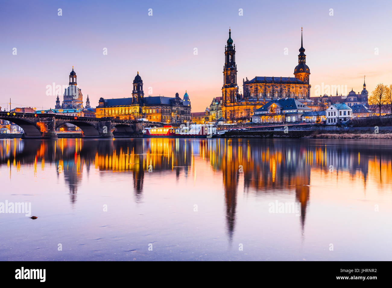 Dresden, Germany. Cathedral of the Holy Trinity or Hofkirche, Bruehl's Terrace. Twilight sunset on Elbe river - Stock Image