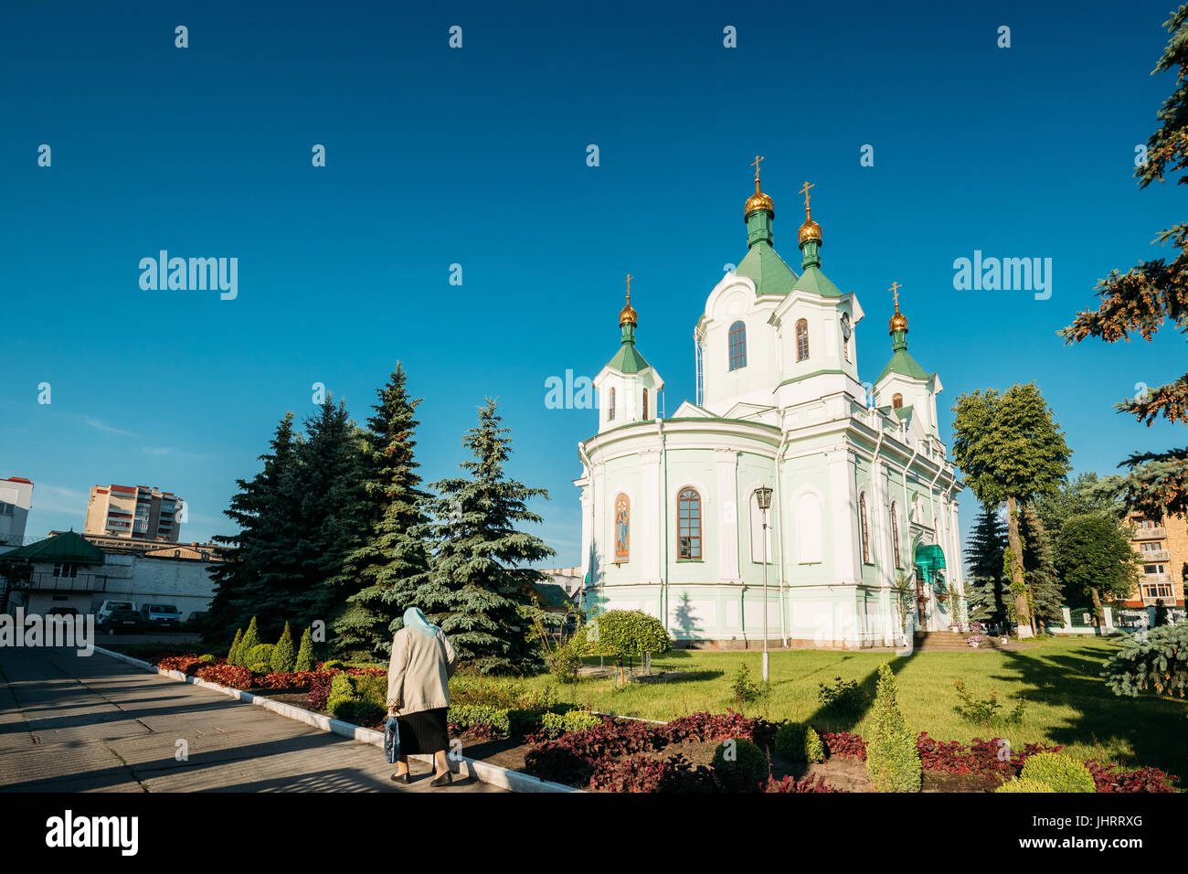 Brest, Belarus. Elderly Woman Walking Near Simeon's Stylites Cathedral Church. - Stock Image