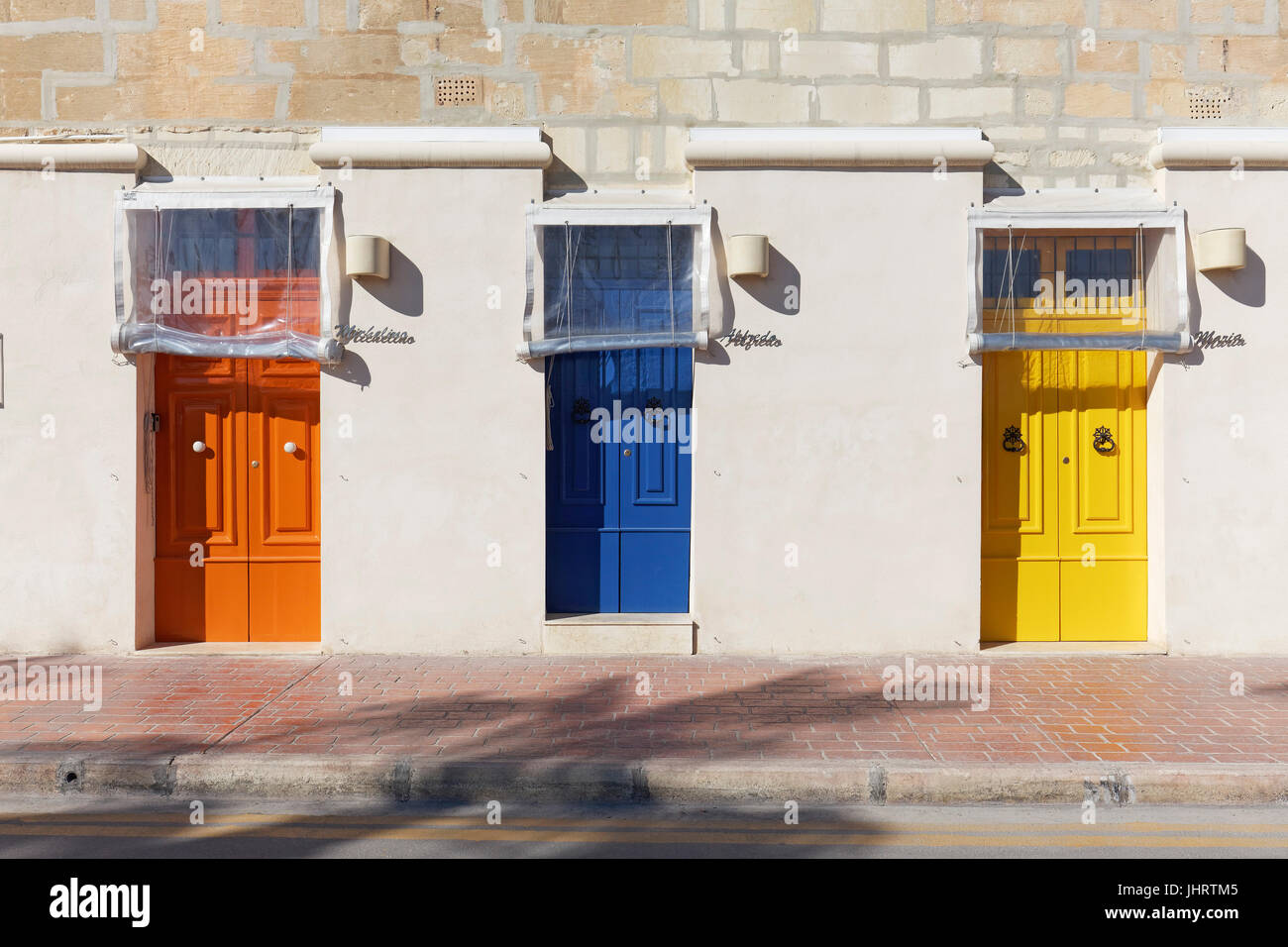 House facade with colorful doors in various colors Marsaxlokk Malta & House facade with colorful doors in various colors Marsaxlokk ...
