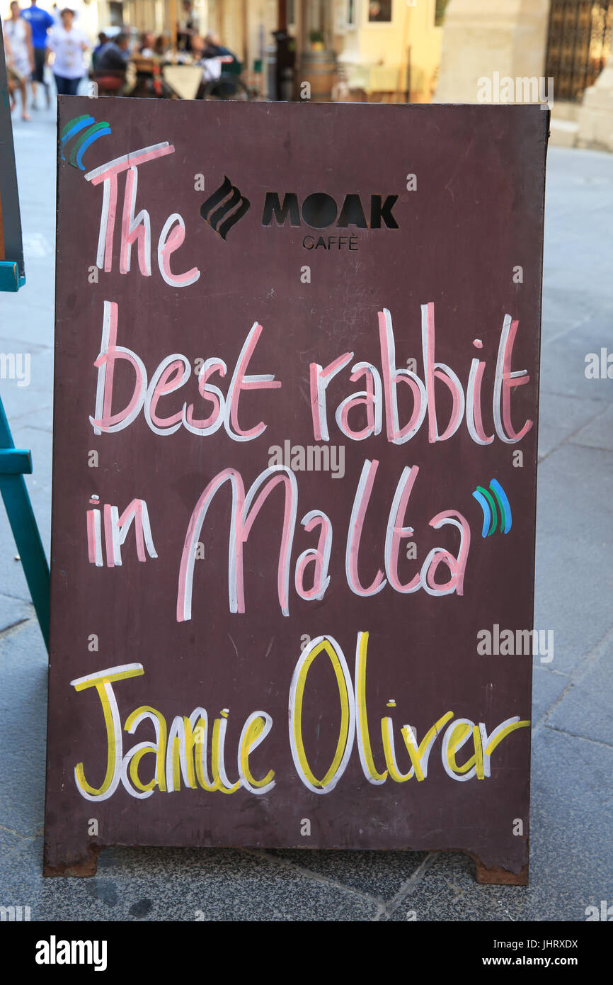 Traditional rabbit dish on the menu in a restaurant on Archbishop Street, in Valletta, capital of Malta - Stock Image
