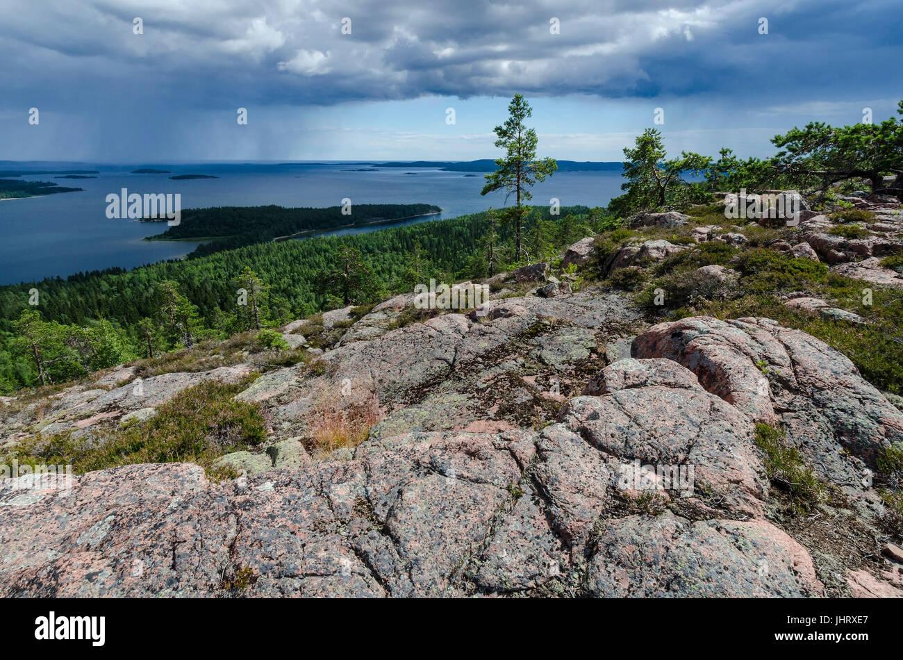 Shower over the Gulf of Bothnia, Skuleskogen national park, world nature heir Hoega Kusten, Vaesternorrland, Sweden, - Stock Image