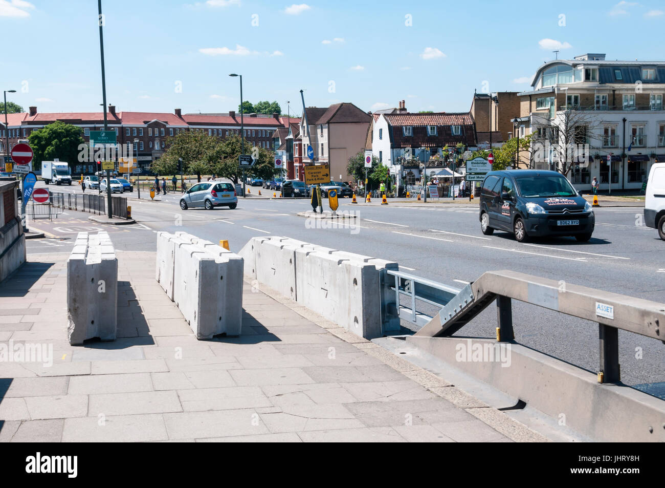 Anti-terrorism or anti-terrorist barriers at the southern end of Hampton Court bridge over the River Thames in London. - Stock Image